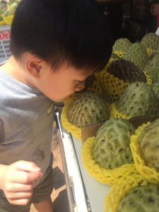 smelling the custard apple